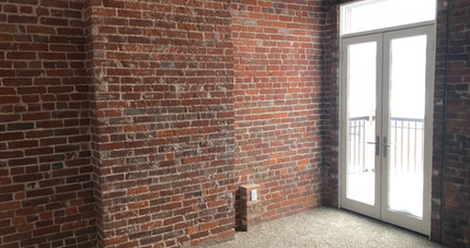 Redstone Lofts 400 Bedroom and Patio.JPG