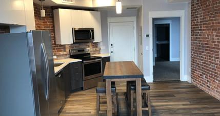 Redstone Lofts 303 Kitchen and Island.JP