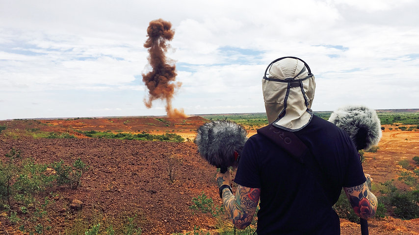 Josh Tucker records explosions for a documentary in Niger