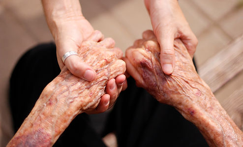 elderly lady and young girl holding hand