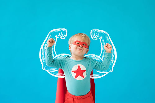Kind im Superman-Kostüm