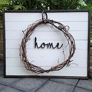 Broken and Restored 'home' sign with wreath.