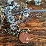 Broken and Restord stamped charm necklace