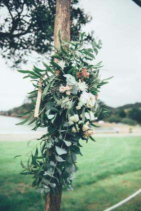 Rustic Arch adn Floral arrangement