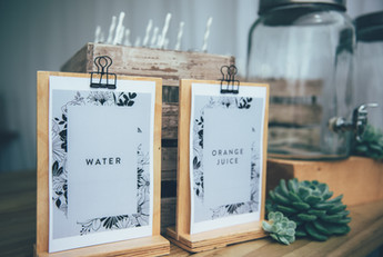 Water and orange juice signs