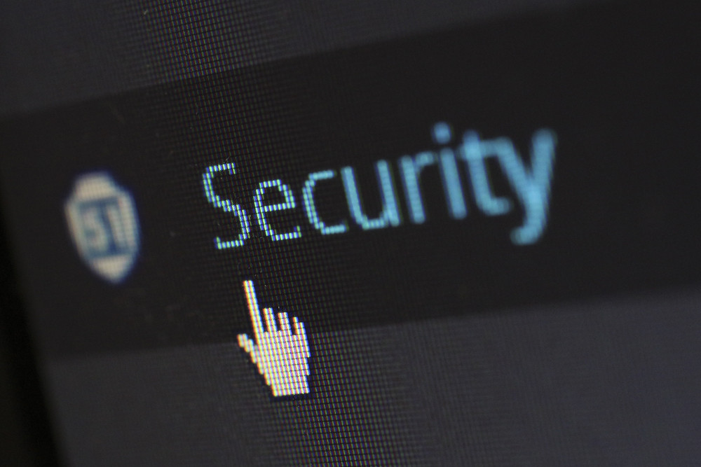 """A cursor hovers over a button that reads """"security"""""""