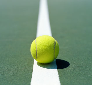 tennis ball on line smaller.jpg