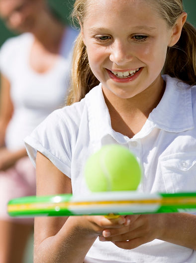 tennis girl balance ball cropped.jpg