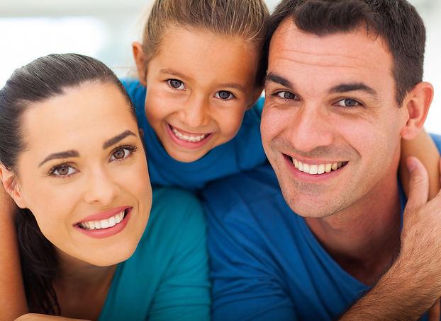 cute%20family%20of%20three%20face%20clos