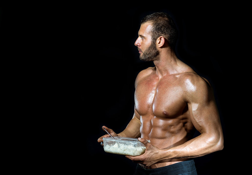 Young adult fit muscular bodybuilder eat