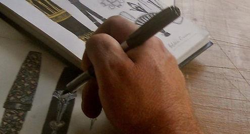 Artist Timothy John designing pens.