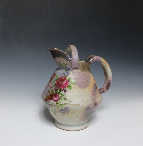 Stoneware, thrown and altered with handbuilt components. Glaze and commercial decals.  Cone 10 Reduction and Cone 018 electric