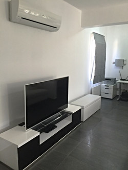 TV AND LITTLE OFFICE UNDER STAIRCASE
