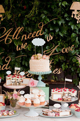 Baby shower setup with cupcakes and cake
