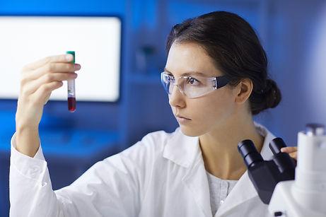 female-scientist-doing-blood-test-UHJ67G