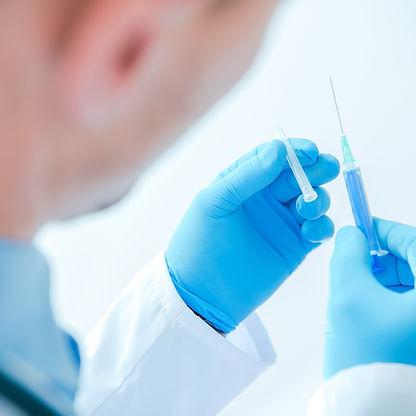 syringe-injection-by-doctor-PG5KHML.jpg