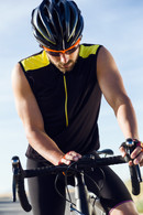 young-cyclist-man-setting-timer-on-bicyc