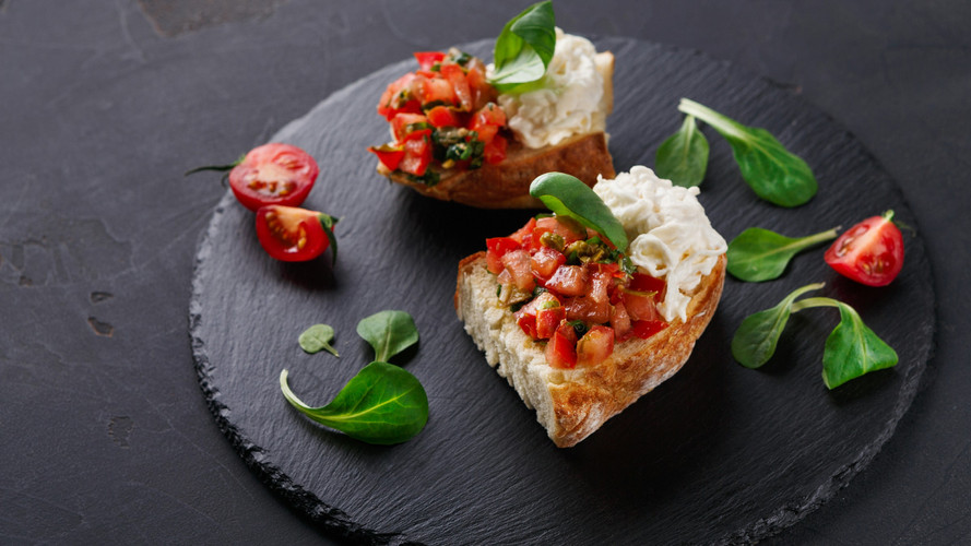 bruschetta-with-cheese-and-vegetables-on