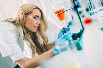female-student-of-chemistry-working-in-l