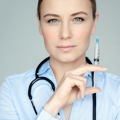 serious-doctor-with-syringe-85VF4LD.jpg