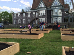Topping off the garden beds