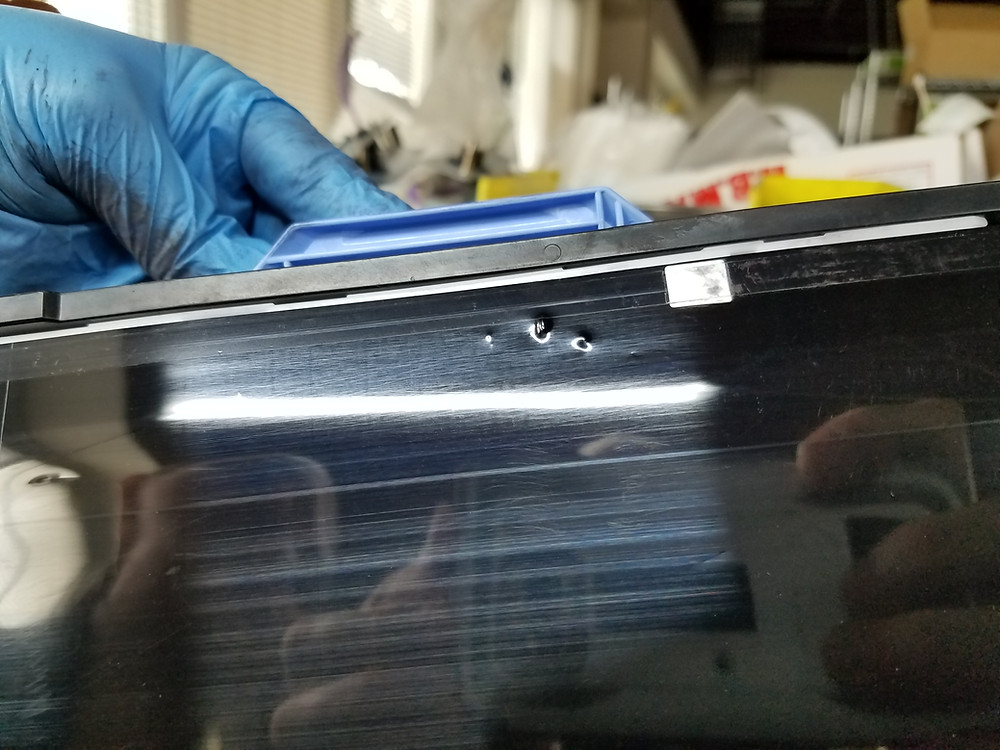 Transfer Belt Ding Damage Will Cause Repetitive Marks Down Page on HP Color Laser Printers