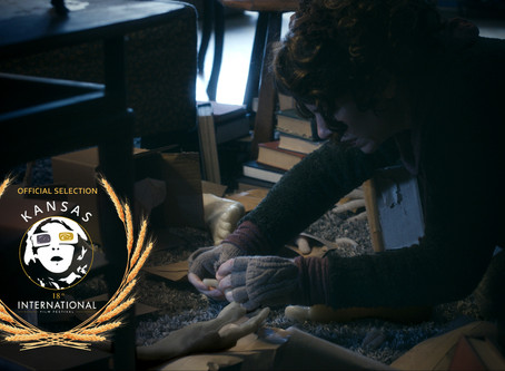 Pay no attention to that man behind the curtain! Writer's Block Official Selection at 18th Kansas