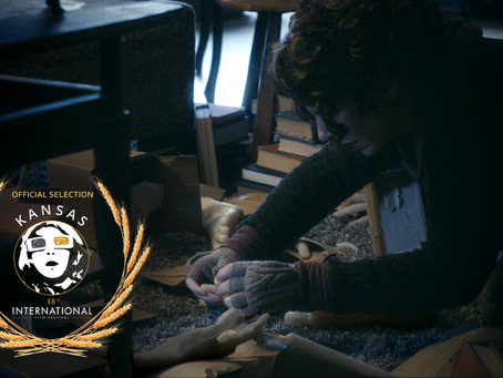 Pay no attention to that man behind the curtain! Writer's Block Official Selection at 18th KIFF