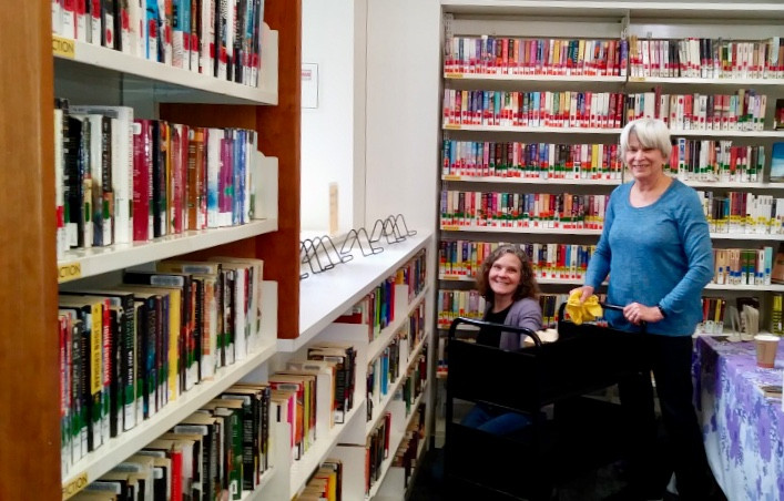 Adult Services Librarian Ally Hack (left) and FORL Director Karen Carlson at work during the spring clean