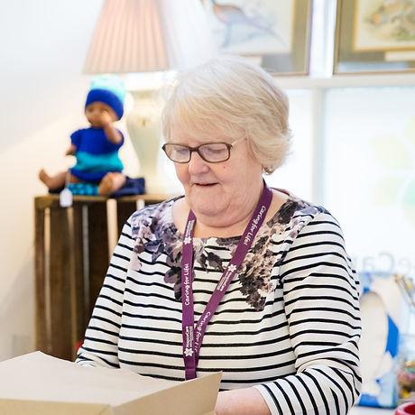 Joan working at the till in Berwick imag