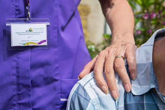 HCA hand on shoulder of client.jpg