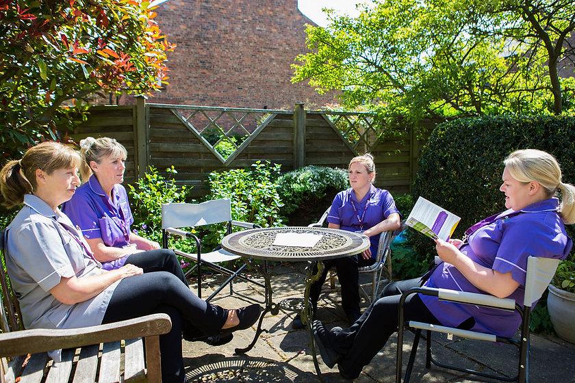 clinical meeting in garden 2.jpg