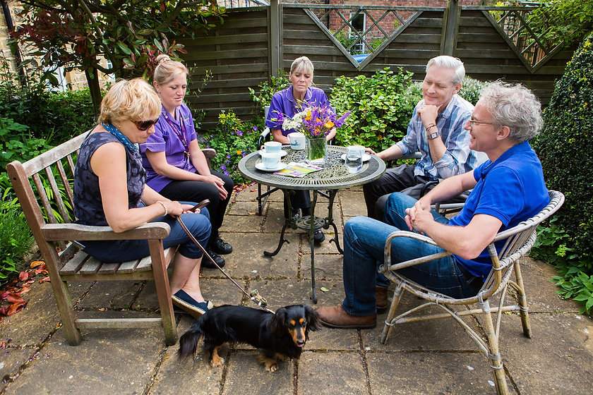 people and nurses  in garden with dog.jpg