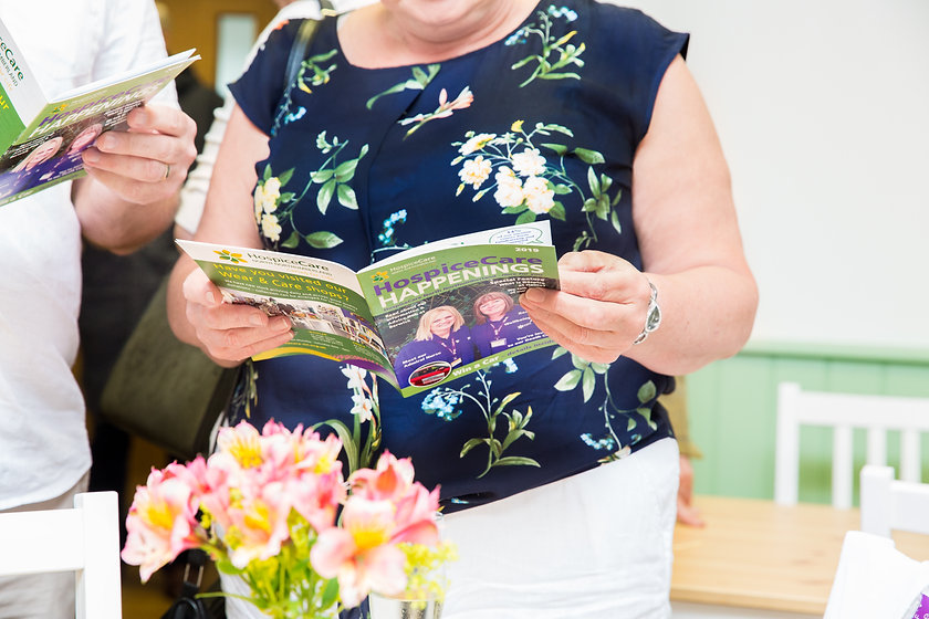 Visitor reading HH019 flowers at table July 2019.jpg