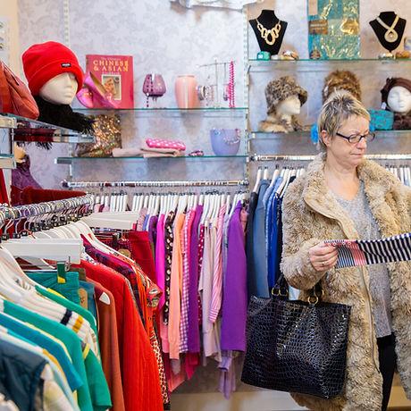 Shopper looking at jumper berwick shop m