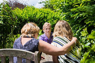 back view of people talking to nurse.jpg