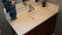How do I clean my Cultured Granite or Marble?