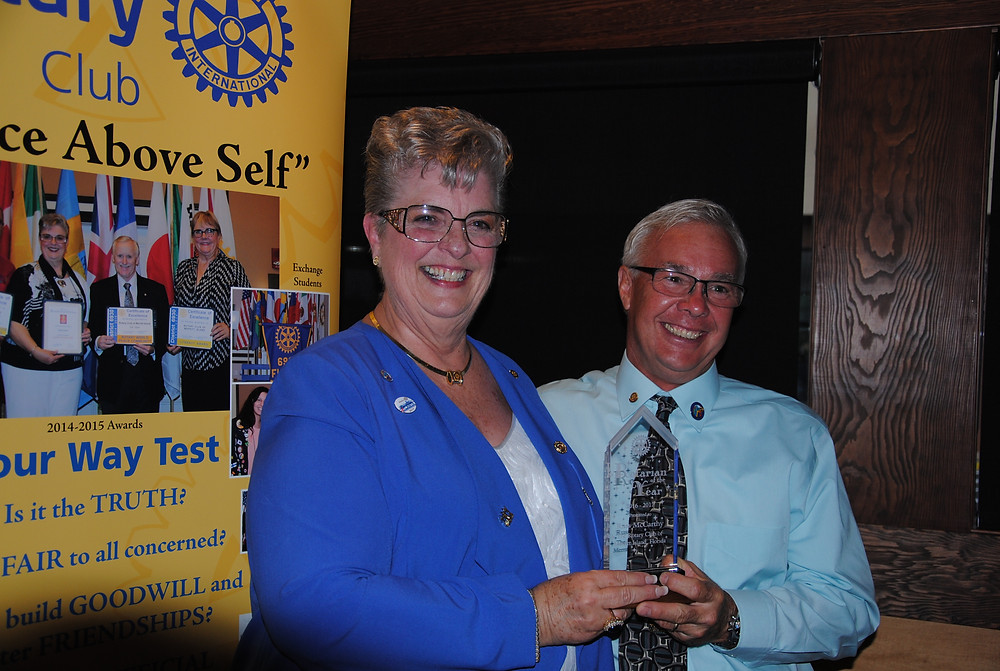 """President Pat Tash presents President Elect Russ McCarthy with the """"Rotarian of the Year"""" Award at the 2017 Board Installation Ceremony."""