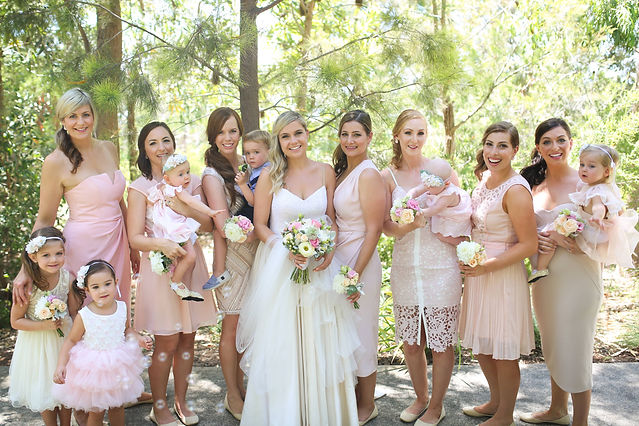 bride tribe; bridal party; flower girls; pink dresses, bouquets; wedding photography; fun wedding party
