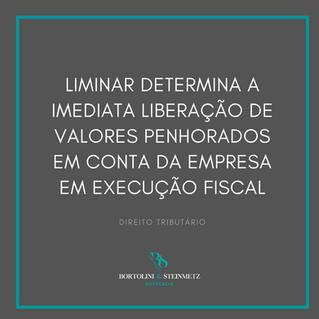 LIMINAR DETERMINA A LIBERAÇÃO DE VALORES PENHORAS EM CONTA CORRENTE DA EMPRESA EM EXECUÇÃO FISCAL