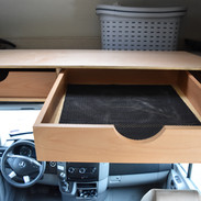 Over the cab storage drawer.