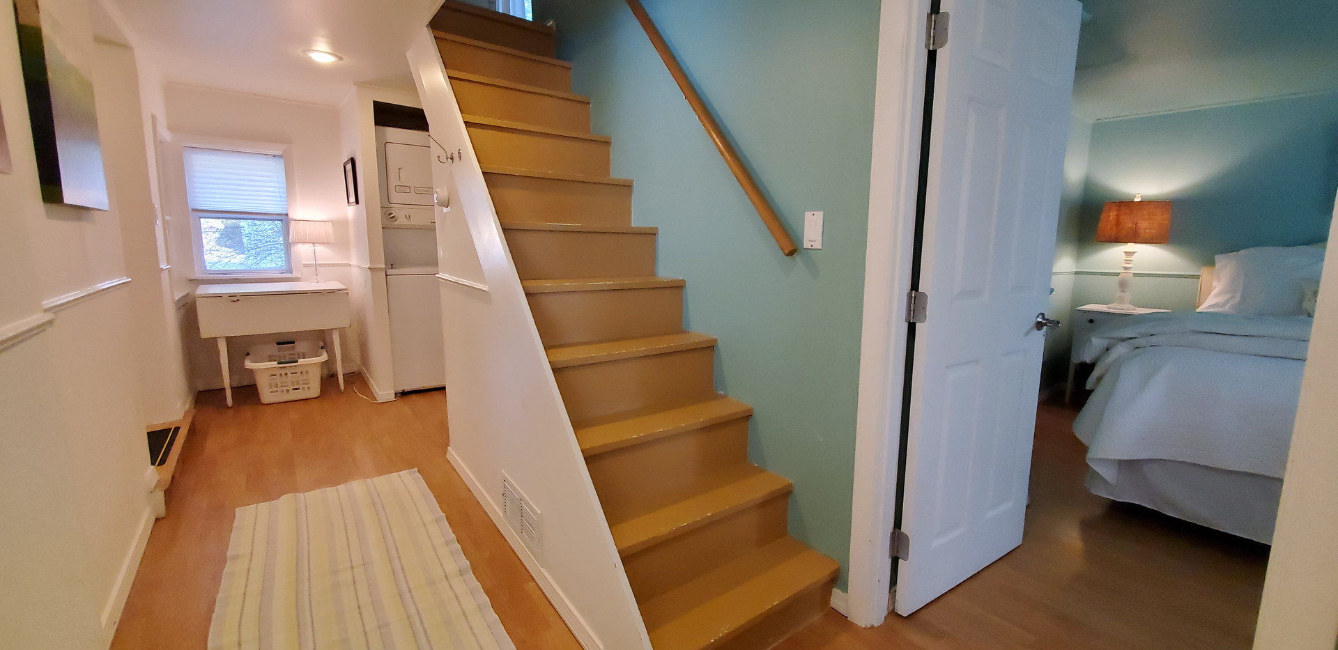Stair to second bedroom and laundry beyond.