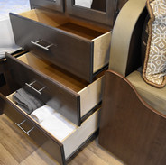 Three ample drawers for clothes and linens.