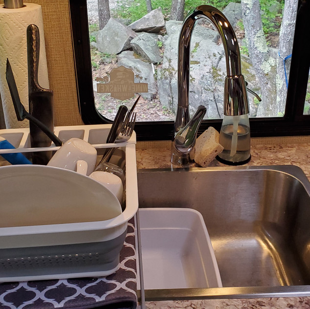 Dish rack and sink basin.