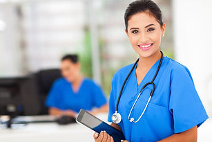 attractive young female nurse holding ta