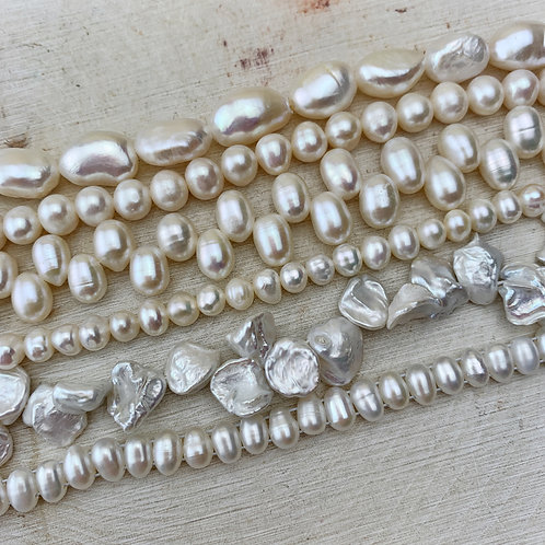 Lot 24 - 6x Strands White Freshwater Pearls