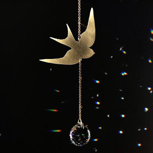 A LITTLE BIRD TOLD ME brass and crystal sun catcher