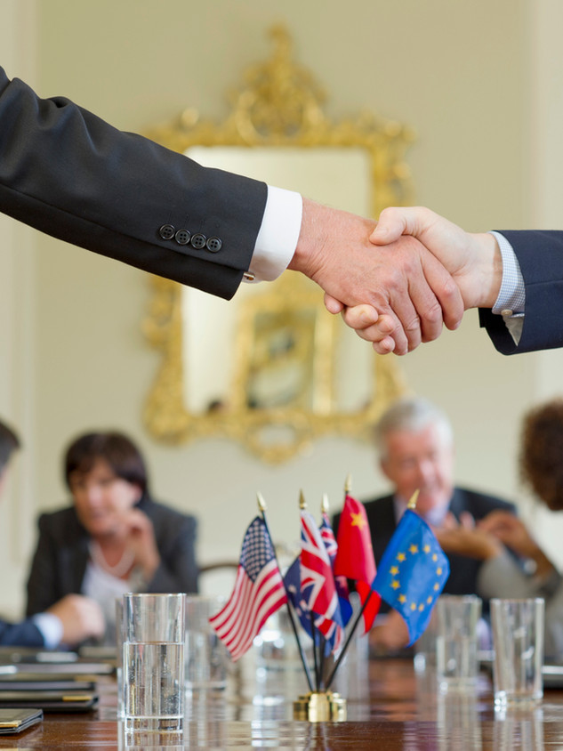 Men shaking hands over a conference table