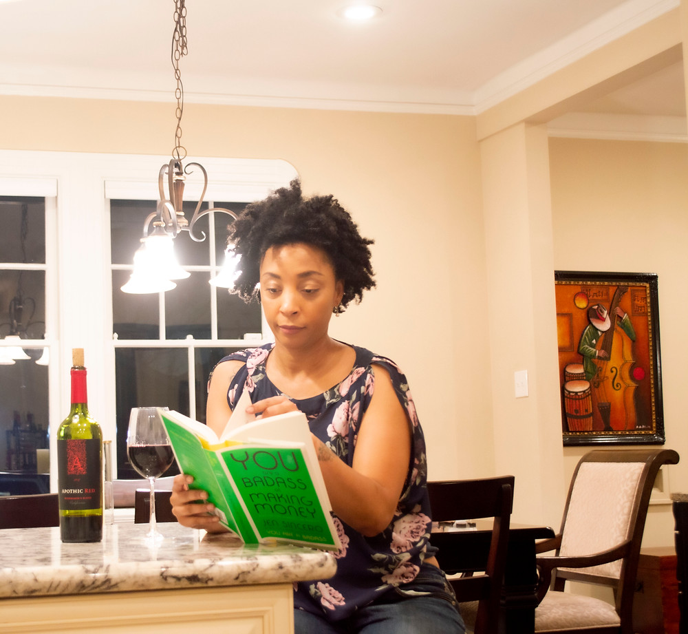 Woman reading You Are a Badass at Making Money