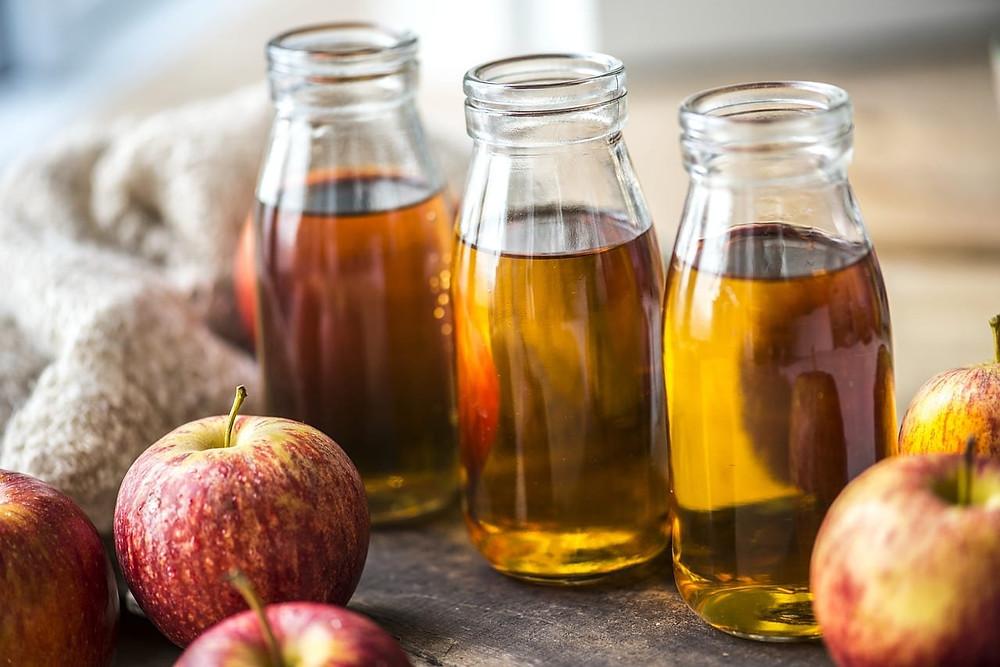Apple cider vinegar in glass jars.
